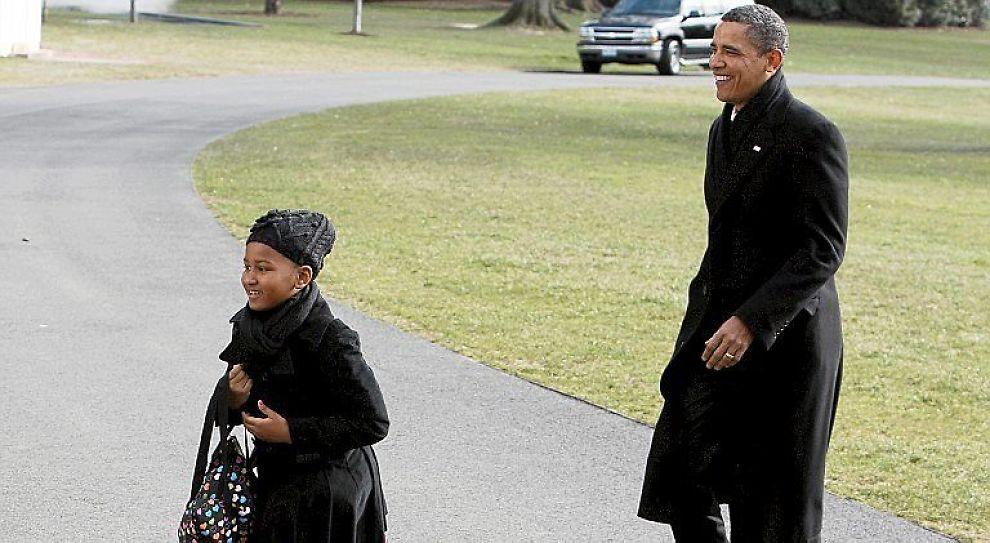 <b>GÅR FØRST</b>: President Barack Obama lar barna gå først - alltid. Her med datteren Sasha.