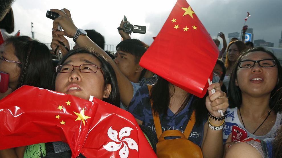 <p><b>LANG KAMP:</b> Det å legge til rett for økt konkurranse fra det private er en jobb den nye ledelsen i Kina har overtatt fra den forrige. Her feirer Kinas nasjonaldag i Hongkong i fjor.<br/></p>