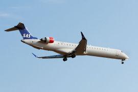 Her er ett av SAS sine 12 regionalfly av typen Bombardier CRJ 900 avbildet i 2009